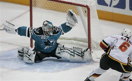 San Jose Sharks goalie Evgeni Nabokov (20), of Kazakhstan, blocks a shot by Calgary Flames defenseman Cory Sarich (6) in the first period in Game 2 of an NHL hockey Western Conference playoff series, Thursday, April 10, 2008, in San Jose, Calif. (AP Photo/Paul Sakuma)