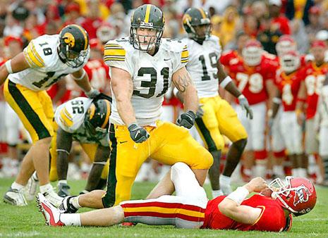 Iowa's Matt Roth flexes overtop ISU quarterback Austin Flynn after sacking him near the ISU goaline in the 3rd quarter.----insano-----Matthew Holst